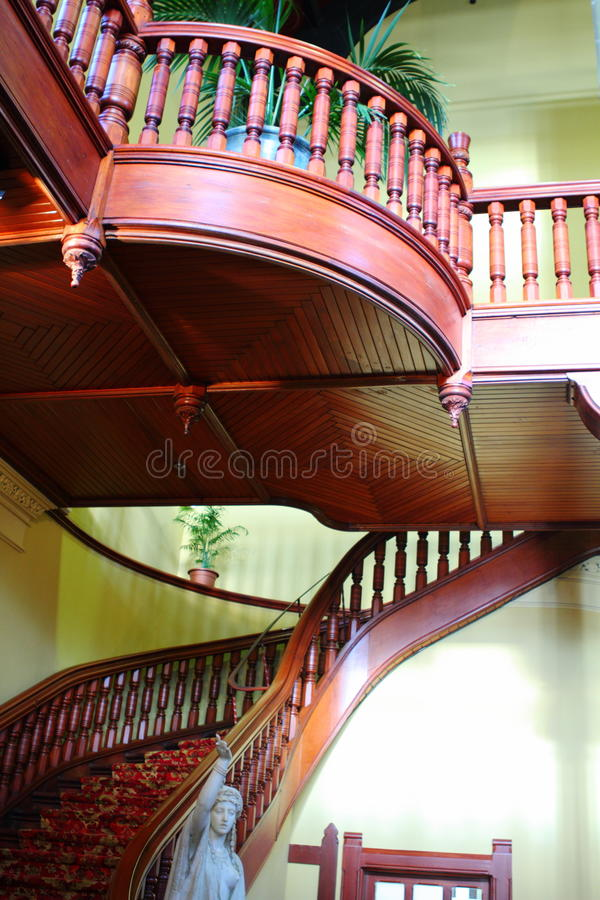 Historic staircase. Beautiful wooden staircase in a historic building stock photo