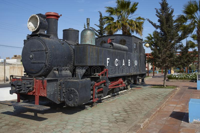 Historic steam engine in the coastal city of Mejillones, Chile stock photos