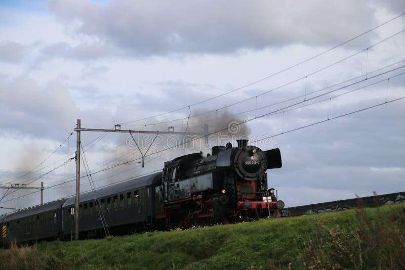 Historic steam locomotive 065 018-4 from the SSN museum on railroad track at nieuwerkerk aan den IJssel in the Netherlands. stock image