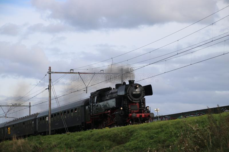 Historic steam locomotive 065 018-4 from the SSN museum on railroad track at nieuwerkerk aan den IJssel in the Netherlands. royalty free stock images