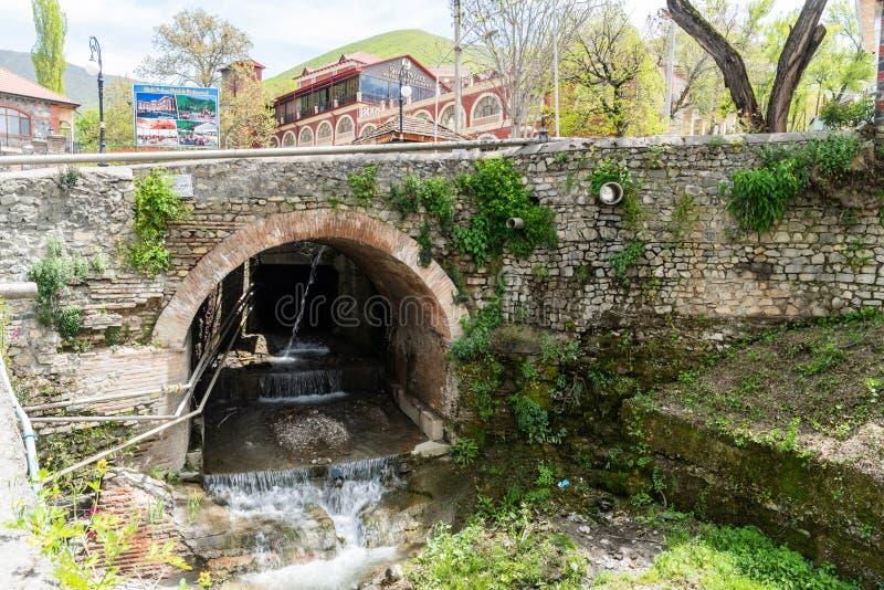 Historic stone bridge, dating from the 18th century, in Sheki, Azerbaijan. Sheki, Azerbaijan - April 29, 2019. Historic stone bridge, dating from the 18th stock photos