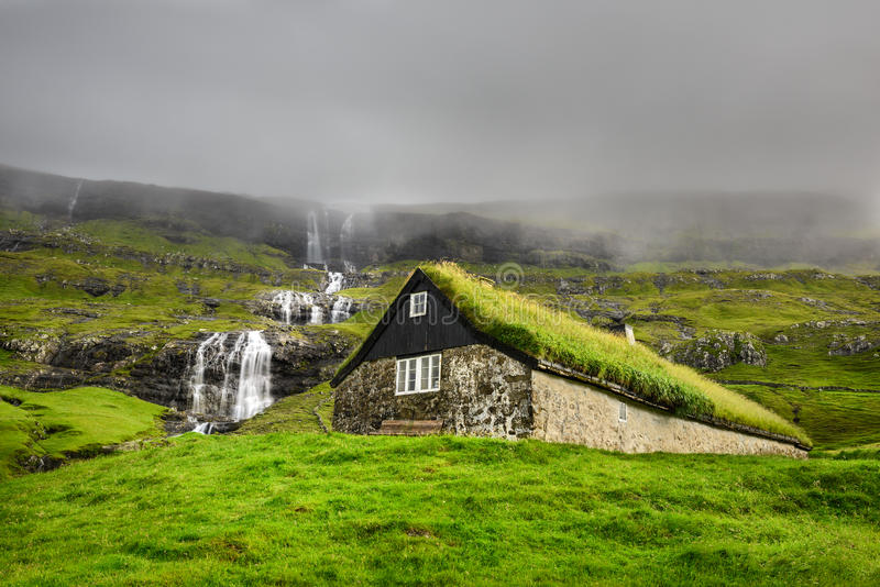 Historic stone house in Faroe Islands. Historic stone house with turf roof on the island of Streymoy, Saksun, Faroe Islands royalty free stock photos
