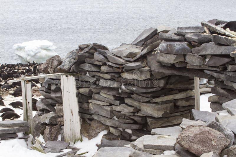 Historic Stone Hut, Paulet Island, Antarctica. Adelie penguins nesting on and around historic Stone Hut on Paulet Island, Antarctica royalty free stock photos
