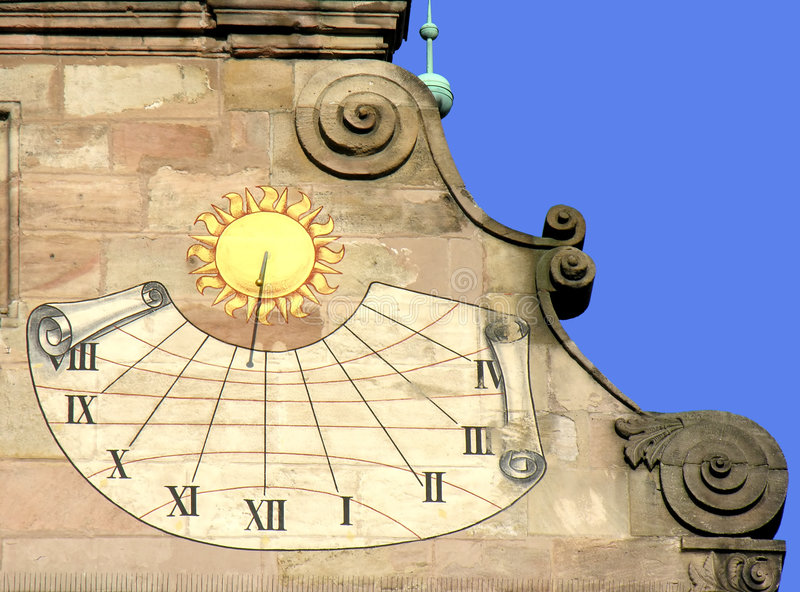 Historic Sundial. A sundial that indicates the time of day by the shadow that is cast on a painted brick wall royalty free stock photography