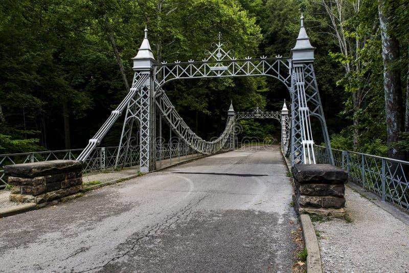 Historic Suspension Bridge - Mill Creek Park, Youngstown, Ohio. A view of a historic suspension bridge in Mill Creek Park in Youngstown, Ohio stock images