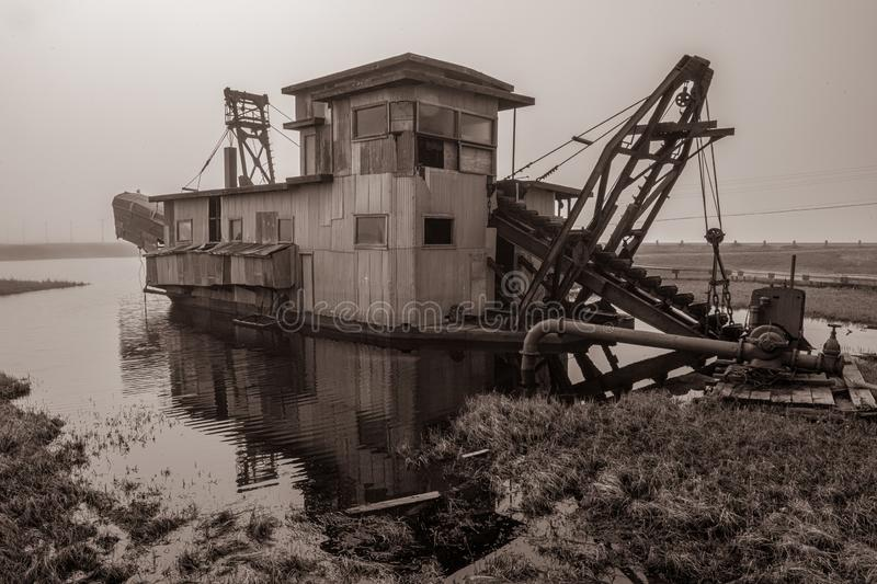 Gold Dredge. The historic Swanberg Dredge once used to mine gold in Nome Alaska stock image