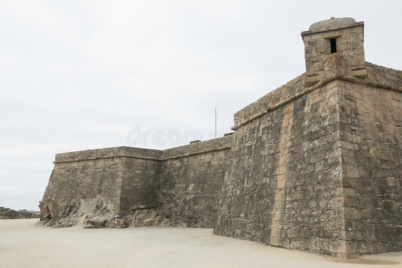 Historic 17th century coastal fort in Vila do Conde, Portugal. Rough stone walls and corner turret. Fort of John the Baptist / Joao Batista royalty free stock photo
