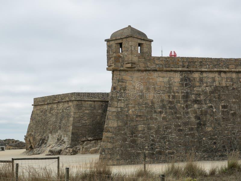 Historic 17th century coastal fort in Vila do Conde, Portugal. Rough stone walls and corner turret. Fort of John the Baptist / Joao Batista stock image