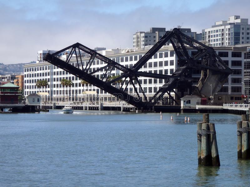 Historic Third Street Bridge lifts to let a boat go under it stock images