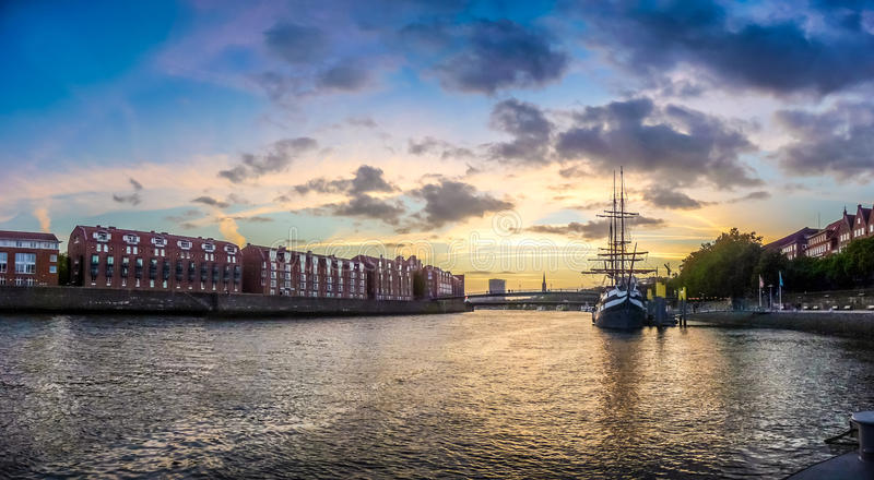 Historic town of Bremen with Weser river with dramatic clouds at. Sunset, Germany royalty free stock images