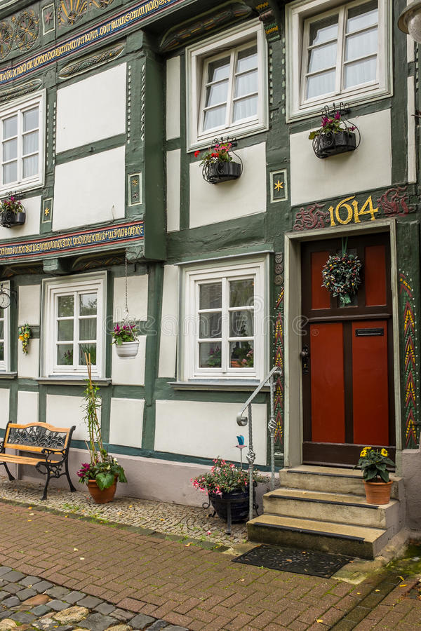 Historic Town House in Goslar, Germany. Colourfully decorated door and windows in an historic 17th century town house. Goslar, Lower Saxony, Germany stock photography