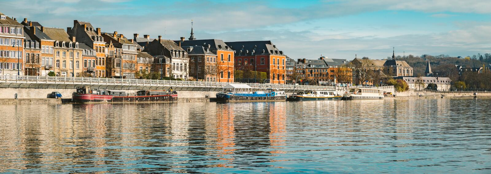 Historic town of Namur with ships along river Meuse, Wallonia, Belgium royalty free stock images