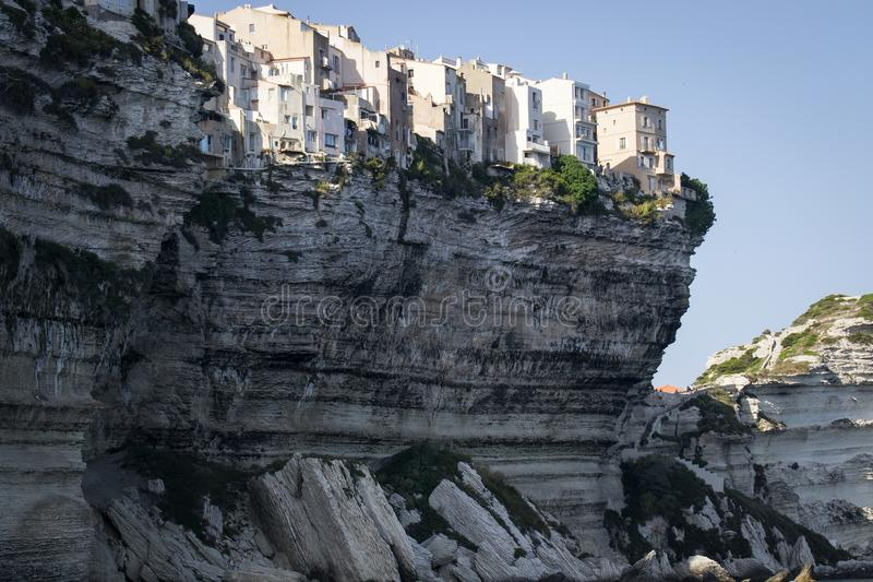Historic town on a white cliff overlooking the sea in the port of Bonifacio stock photography
