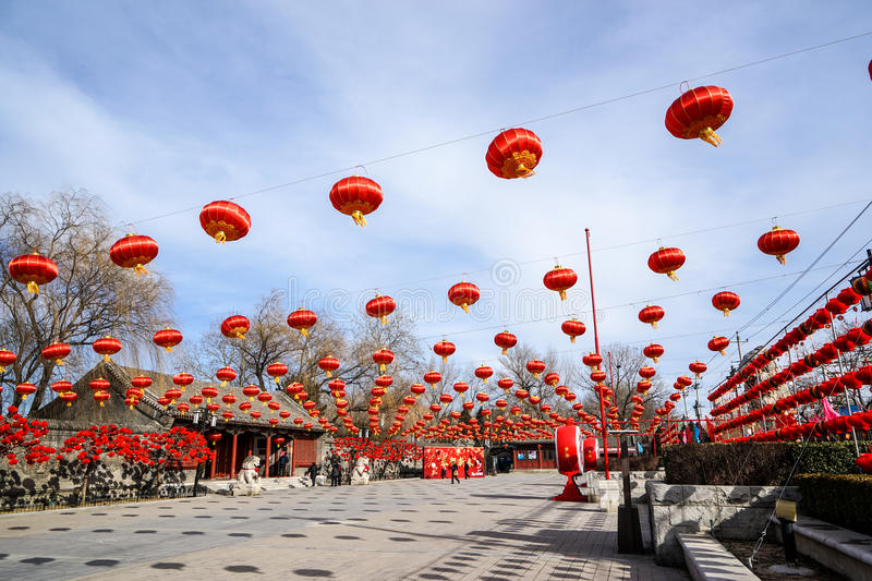 Historic Traditional Garden of Beijing, China in winter, during Chinese New Year. The traditional oriental buildings with red lanterns at sunny day in winter on royalty free stock photos