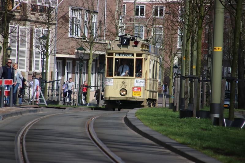 Historic tram 77 known as Ombouwer of the HTM on the rails in The Hague stock photography