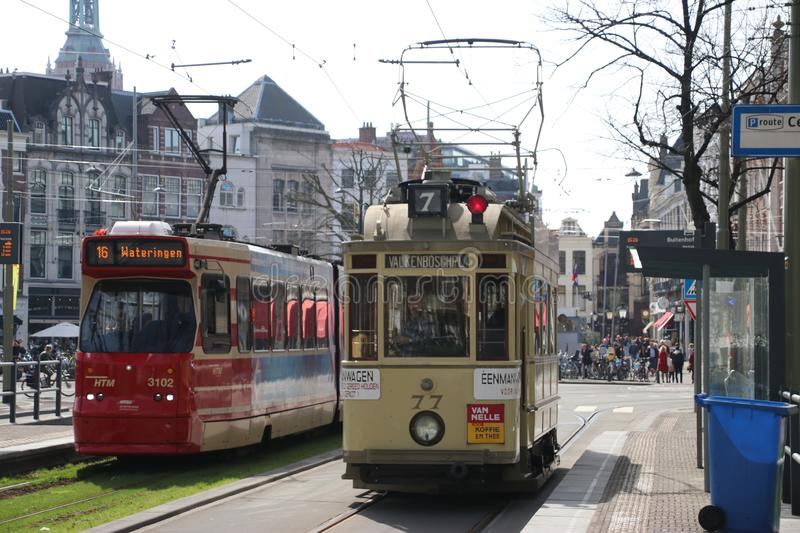Historic tram 77 known as Ombouwer of the HTM on the rails in The Hague on the Lange Vijverberg as Museum Tram with normal GLT stock photo