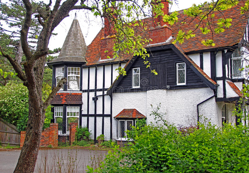 Historic tudor style barn house. Photo of historic victorian Barn House in tudor style located in whitstable kent which has served as a hospital and holiday home stock photography