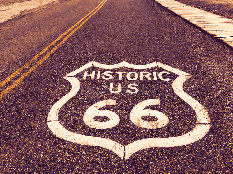 Historic US Route 66 highway sign on asphalt in Oatman, Arizona, United States. The picture was made during a motorcycle road trip royalty free stock photo