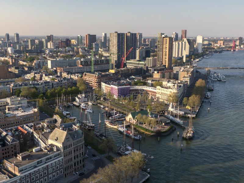 Historic Veerhaven with sail boats in Rotterdam harbour next to the maas river. Aerial view of the Veerhaven in Rotterdam. Sail ships are moored in the harbour royalty free stock photography