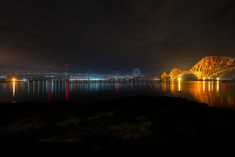 The historic red Victorian Forth rail bridge on the right w stock images