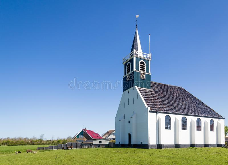 Old village church Oudeschild on Texel island in the Netherlands. Historic village church Zeemanskerk in Oudeschild on the Wadden island Texel in the Netherlands stock photography