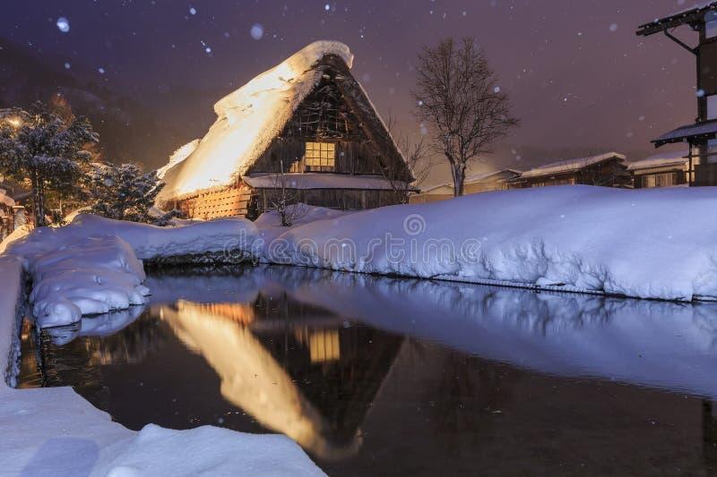 Historic Villages of Shirakawa-go in a snowy day. At night stock photos