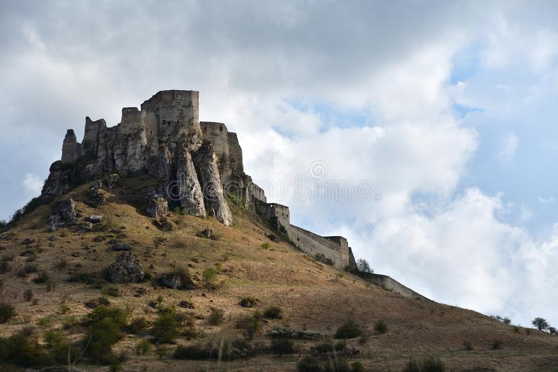 Walls of the ruin of a historic castle in the countryside Spis Slovakia. Historic walls of the ruins of a historic castle Spis Slovakia stock photo