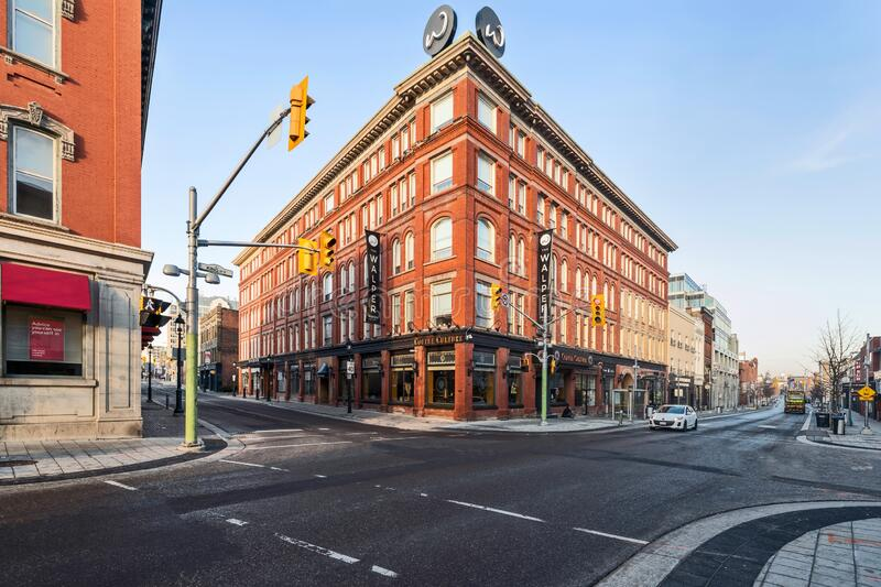 Historic Walper Hotel located at main intersection in Kitchener, Ontario, Canada. Kitchener, Canada - March 26, 2020: View at the historic Walper Hotel located stock images