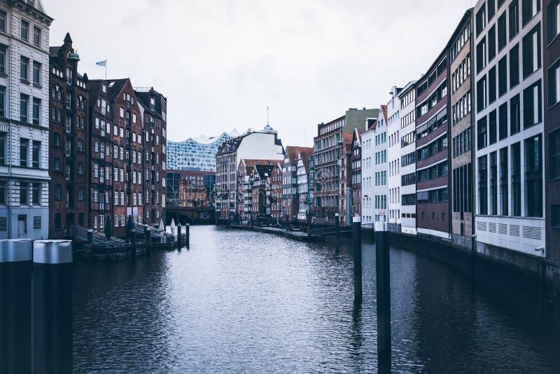 Historic warehouses at Nikolaifleet canal in Hamburg stock photo