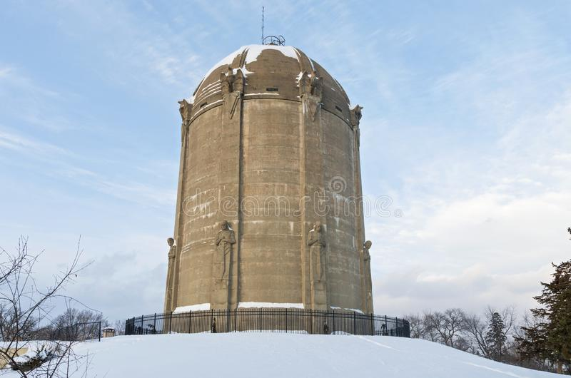 Historic Water Tower in Tangletown. Historic landmark water tower listed on national historic register atop snow covered  hill in tangletown neighborhood of royalty free stock photo