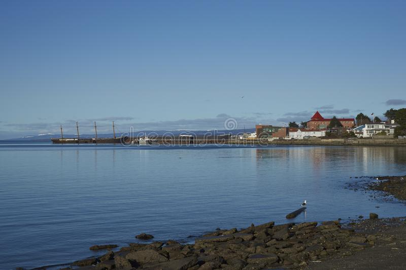 Historic waterfront of Punta Arenas, Chile. Historic waterfront of Punta Arenas running along the Magellan Strait in Patagonia, Chile. Moored alongside the pier royalty free stock image