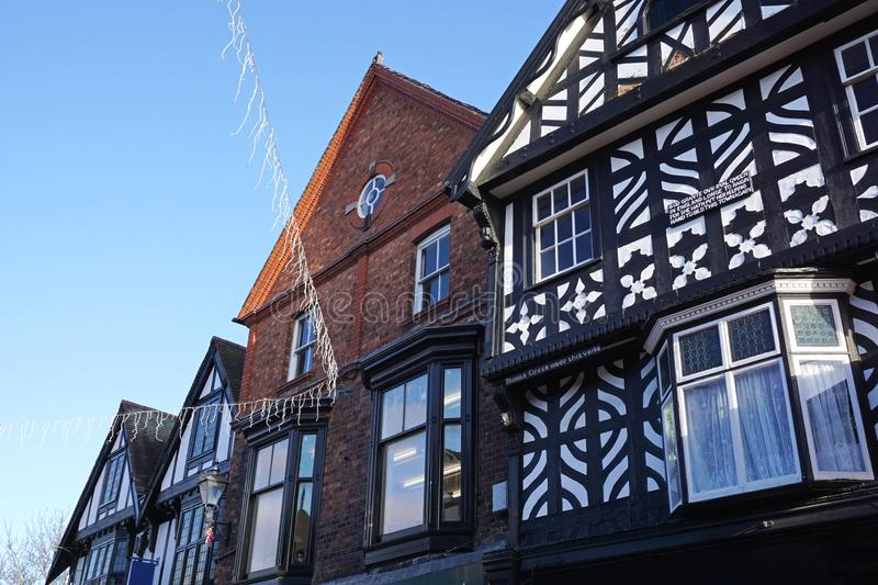 Historic Wattle And Daub Building, Nantwich, Cheshire, England. Close up of old black and white and red brick buildings in the town of Nantwich, Cheshire royalty free stock photography