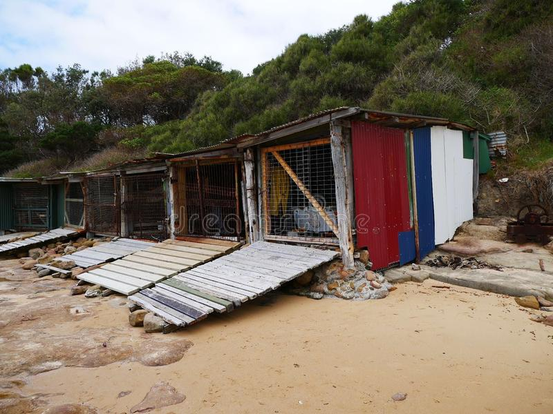 Historic weathered boat sheds stock images