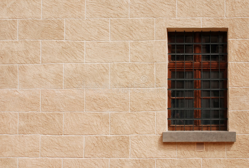 Historic window. Stone wall with old window stock photo