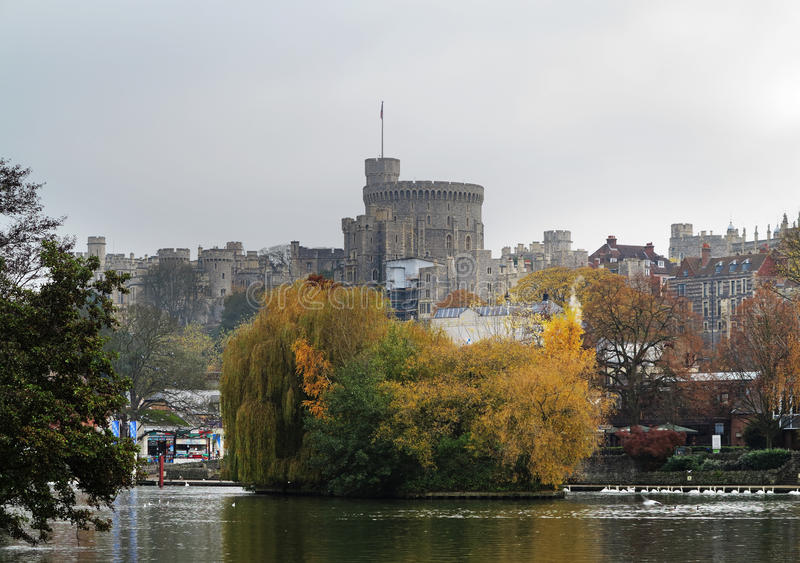 Historic Windsor Castle from the River Thames. Autumn over Windsor Castle in the Royal County of Berkshire in Southern England, the residence of HRH Queen stock photography