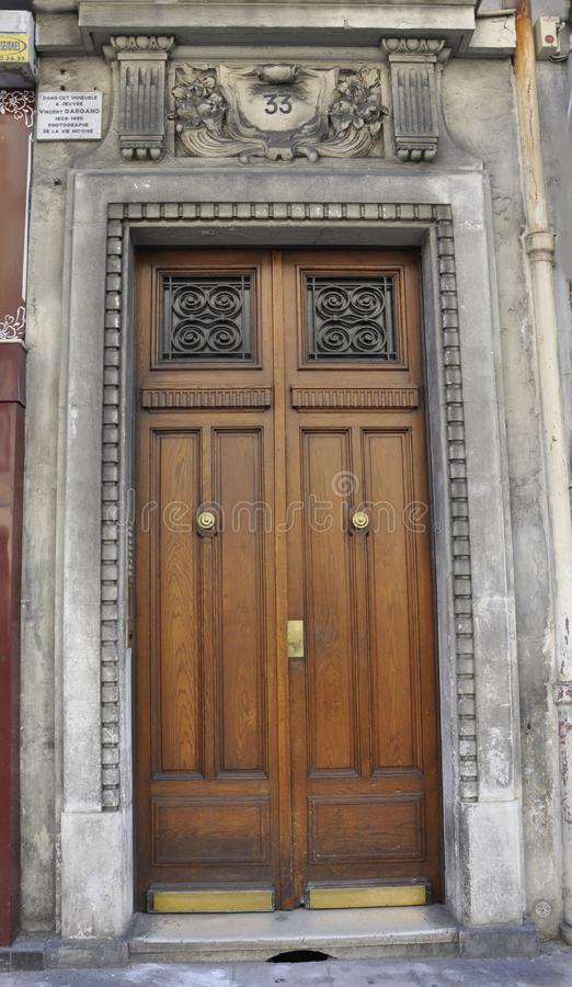 Nice, 5th september: Wooden Door with decorative frame from building in Nice France stock image