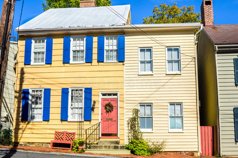 Historic Wooden Town House. Town House with Colourful Shutters and Door stock photography