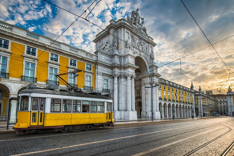 Historic yellow tram in Lisbon, Portugal. Historic yellow tram in front of Arco da Rua Augusta in Lisbon, Portugal stock image