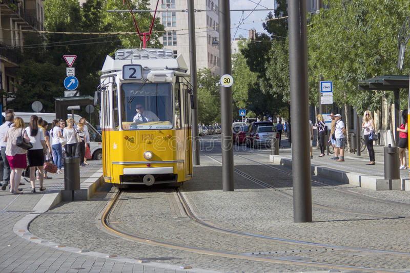 Historic yellow tram on the street of Budapest stock photo