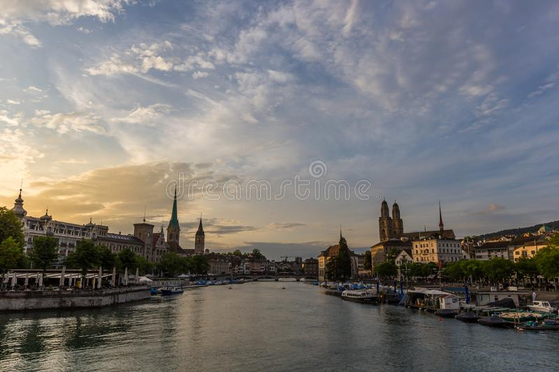 Historic Zurich downtown skyline with Fraumunster and Grossmunster churches at lake zurich during sunset, Switzerland royalty free stock image