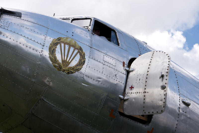 Historical aircraft Douglas DC-3. KARLSBORG, SWEDEN - AUGUST 14, 2016: Historical aircraft Douglas DC-3, one of the most significant transport aircraft ever made royalty free stock photos