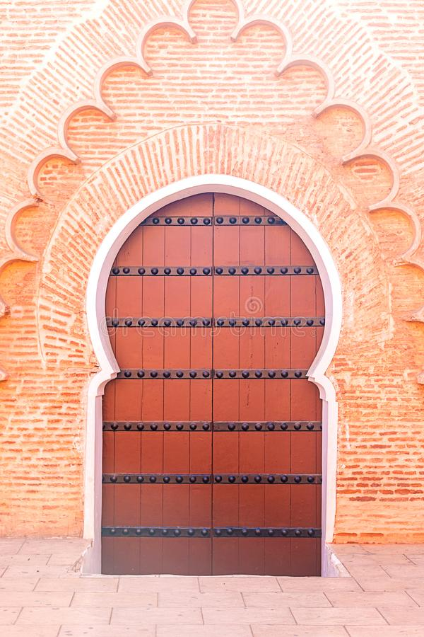 Historical in antique building door morocco style africa wood and metal rusty. Morocco royalty free stock photography