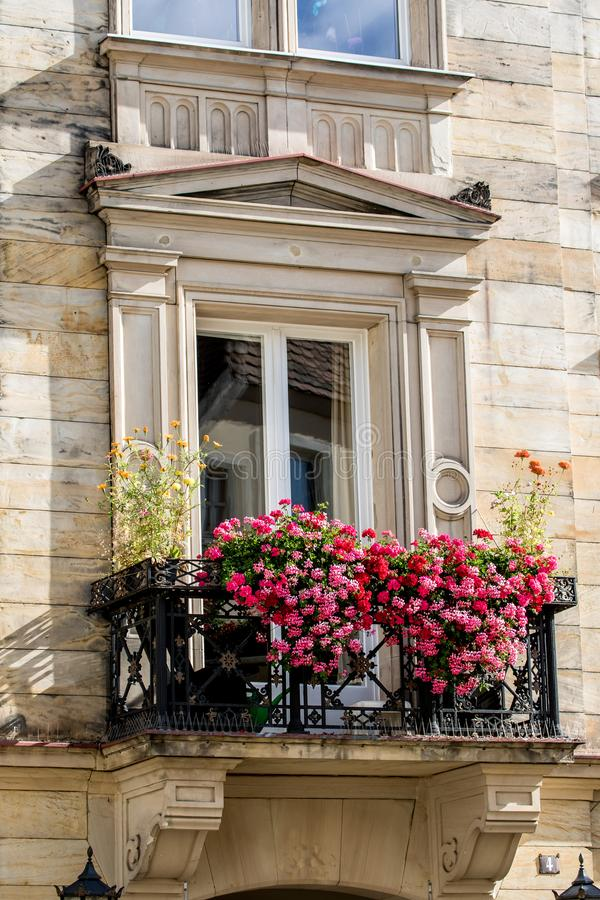 Historical balcony with flowers - Bayreuth old town stock image