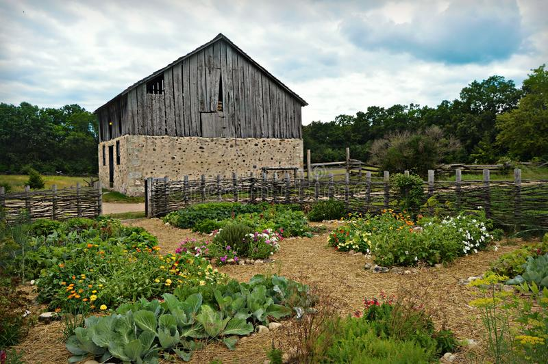 Historical Barn With Flower Garden Stock Image - Image of trees ...
