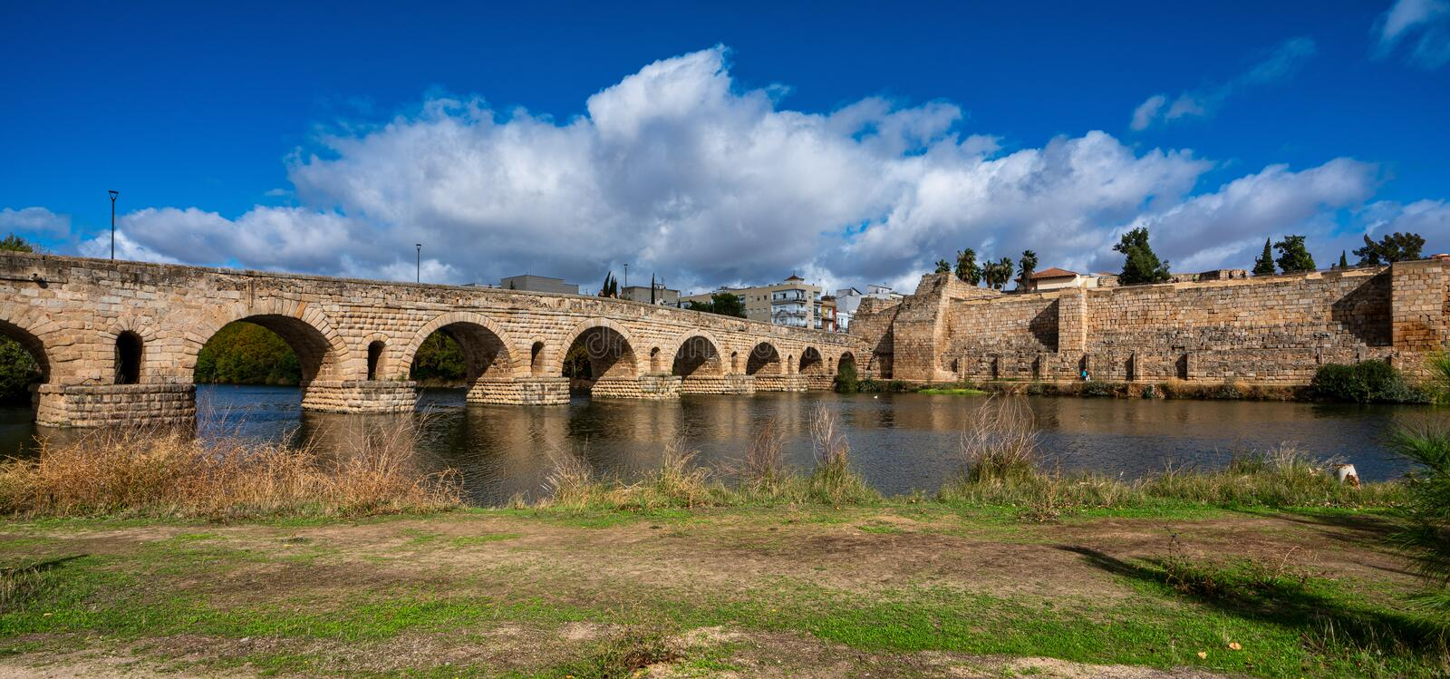 Puente Romano, the Roman Bridge in Merida with the Alcazaba, Extremadura, Spain royalty free stock photo