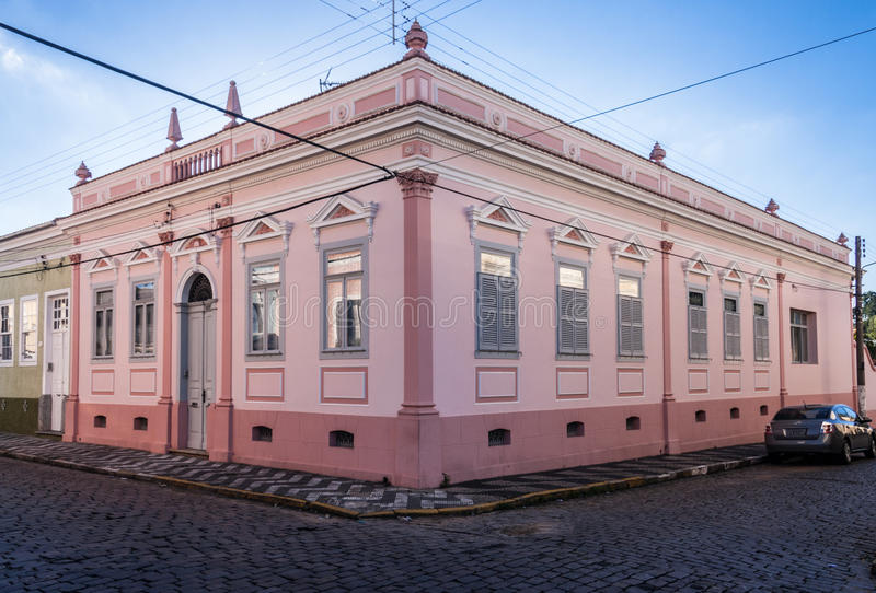 Historical Building in Amparo. The facade of a pink colonial historical building on a corner of Amparo, Sao Paulo, Brazil stock photography