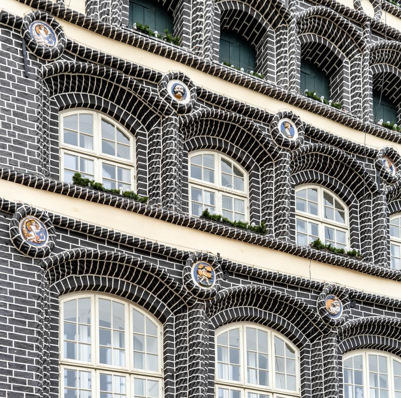 Historical building with black bricks and decorations on the façade. Historical building with black bricks and decorations on the façade royalty free stock photography