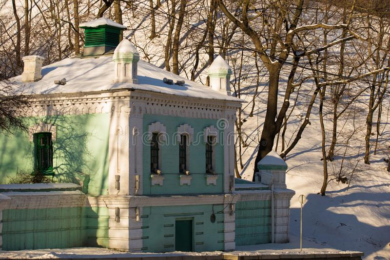 Historical building in the city of Kiev, wintertime. Landscape with the historical building covered with the snow in the city of kiev royalty free stock image