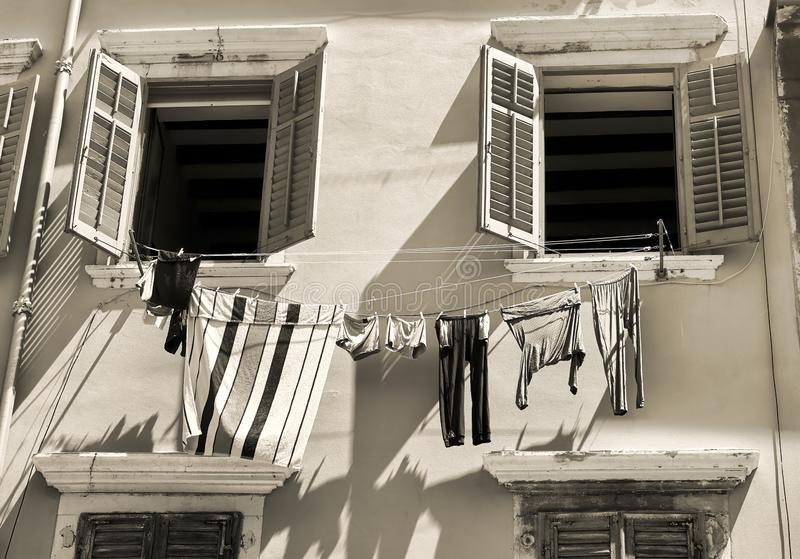 Historical building with clothesline in Rovinj. Historical building with clothesline in the old town of Rovinj in Croatia royalty free stock photography