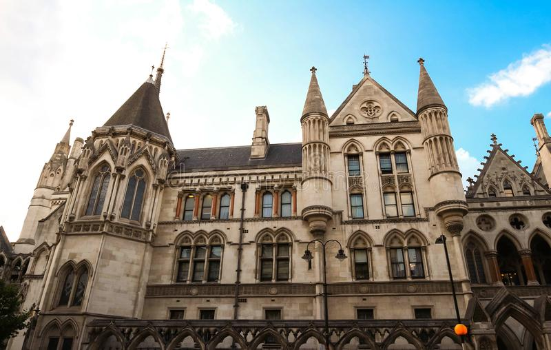 Historical building and entrance of Royal Courts of Justice in London ,England. The historical building and entrance of Royal Courts of Justice in London stock image